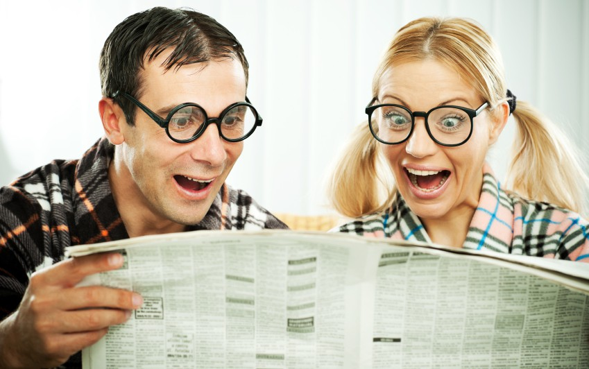 Couple holding the newspaper. White background.   [url=http://www.istockphoto.com/search/lightbox/9786786][img]http://dl.dropbox.com/u/40117171/couples.jpg[/img][/url]